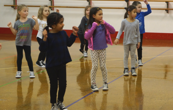 Elementary aged hip hop dancers participate in class.