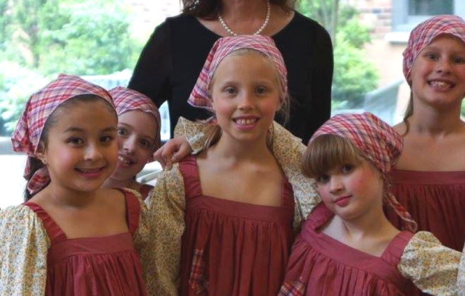 Actors and dancers prepare for a performance of Annie.