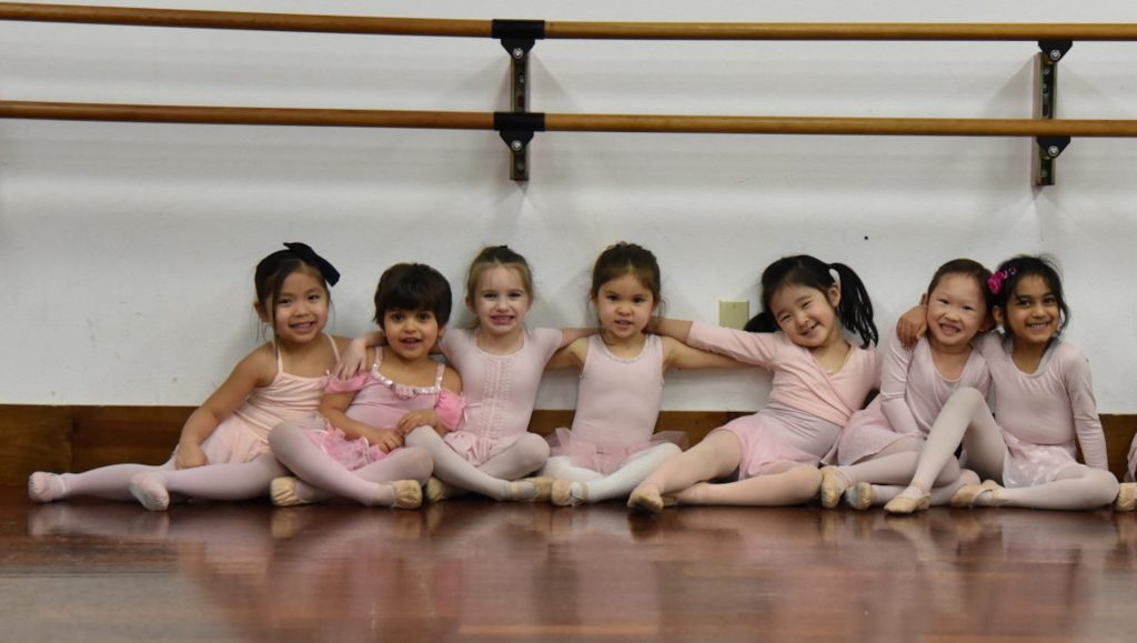 Preschool aged dancers take ballet lessons.
